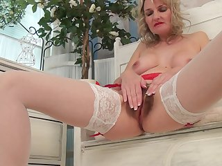 Foxy blonde mature Roxy Jay opens her legs to finger her muted cunt