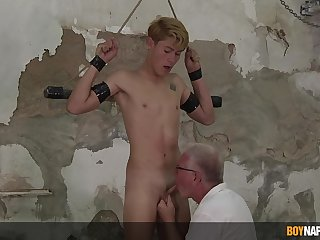 Obedient twink gets sucked by an pa in pure BDSM gay porn