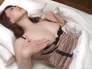 Older Asian lady is part demure inclusive and part sizzling sex kitten
