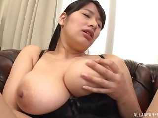 Busty Japanese chick Haruna Hana plays with her giant melons