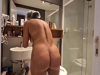 Brazilian ebony haired with large, indestructible hooters, Bianca Naldy is getting banged from the back, in the shower