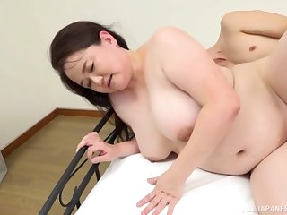 Chubby Asian Sakuragi Junko reaches an amazing back away from with a dude