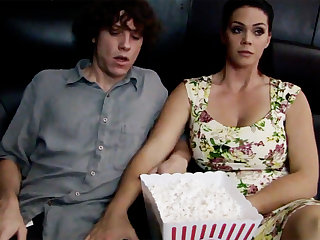 Sultry milf touch shy stepson's dick in cinema